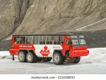 COLUMBIA ICEFIELD, ALBERTA, CANADA - JUNE 2018: Massive six wheel purpose-built tourist excursion vehicle stopped on the Athabasca Glacier in the Columbia Icefield in Alberta, Canada.
