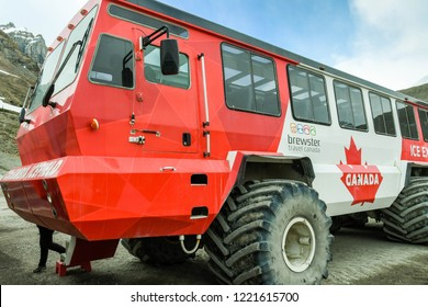 COLUMBIA ICEFIELD, ALBERTA, CANADA - JUNE 2018: Close up view of huge six wheel purpose-built vehicle which takes tourists onto the Athabasca Glacier in the Columbia Icefield in Alberta, Canada.