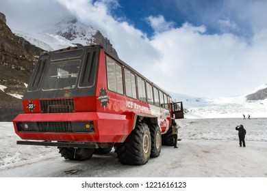 COLUMBIA ICEFIELD, ALBERTA, CANADA - JUNE 2018: Massive six wheel purpose-built vehicle which takes tourists onto the Athabasca Glacier in the Columbia Icefield in Alberta, Canada.