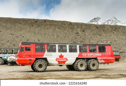 COLUMBIA ICEFIELD, ALBERTA, CANADA - JUNE 2018: Huge six wheel purpose-built vehicle which takes tourists onto the Athabasca Glacier in the Columbia Icefield in Alberta, Canada.