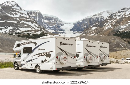 COLUMBIA ICEFIELD, ALBERTA, CANADA - JUNE 2018: Row of camper vans parked at the Columbia Icefield Visitor centre in Alberta, Canada.