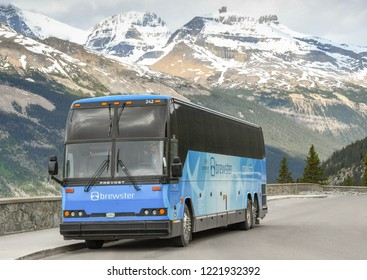 COLUMBIA ICEFIELD, ALBERTA, CANADA - JUNE 2018: Shuttle bus in the Columbia Icefield area, which transports visitors to and from the Athabasca Glacier and the Skywalk attraction in Alberta, Canada.
