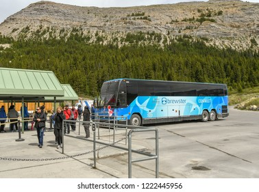 COLUMBIA ICEFIELD, ALBERTA, CANADA - JUNE 2018: People arriving back by shuttle bus at the Columbia Icefield Visitor Centre  after visiting the Athabasca Glacier in Alberta, Canada.