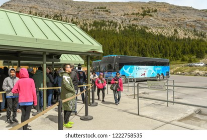 COLUMBIA ICEFIELD, ALBERTA, CANADA - JUNE 2018: People waiting to depart by shuttle bus from the Columbia Icefield Visitor Centre  to visit the Athabasca Glacier in Alberta, Canada.