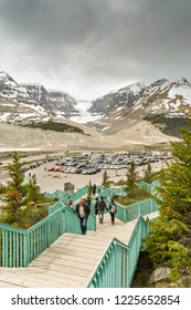 COLUMBIA ICEFIELD, ALBERTA, CANADA - JUNE 2018: Cars parked at the Columbia Icefield Visitor centre in Alberta, Canada.