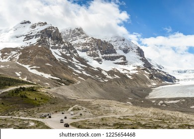 COLUMBIA ICEFIELD, ALBERTA, CANADA - JUNE 2018: The Athabasca Glacier in the Columbia Icefield in Alberta, Canada. The scale can be seen middle left by the trucks and people.