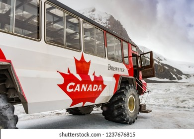 COLUMBIA ICEFIELD, ALBERTA, CANADA - JUNE 2018: Large six wheel purpose-built vehicle which takes tourists onto the Athabasca Glacier in the Columbia Icefield in Alberta, Canada.