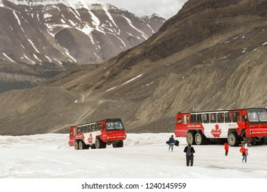 COLUMBIA ICEFIELD, ALBERTA, CANADA - JUNE 2018: Massive six wheel purpose-built vehicles which take tourists onto the Athabasca Glacier in the Columbia Icefield in Alberta, Canada.