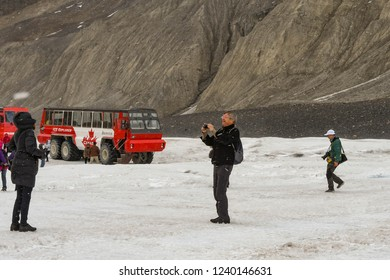 COLUMBIA ICEFIELD, ALBERTA, CANADA - JUNE 2018: Person taking a picture on the Athabasca Glacier in the Columbia Icefield in Alberta, Canada.