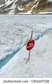 COLUMBIA ICEFIELD, ALBERTA, CANADA - JUNE 2018: Warning sign marking the boundary of the safe area for tourists visiting the Athabasca Glacier in the Columbia Icefield in Alberta, Canada.