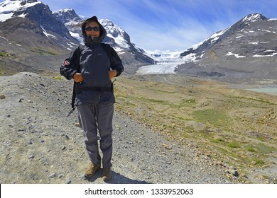 COLUMBIA ICEFIELD, CANADA - JULY 9, 2018: Visitors to Columbia icefield in Jasper National Park, Athabasca Glacier retreating, Canadian rockies - UNESCO World Heritage Site