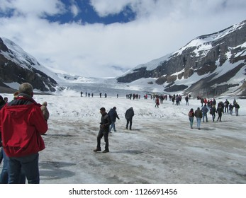 Columbia Icefield, Canada on 01.06.2018: Masses of tourists climbing on the Icefield