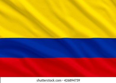 columbia national realistic flag on the fabric texture background