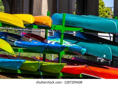 Columbia, PA, USA - August 21, 2015: A rack of colorful canoes available for rent at the Susquehanna River in Pennsylvania.
