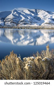 Columbia River Flows After Fresh Snow beneath Mountain Peaks and Homesteads