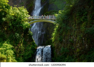 Columbia River Gorge, Oregon - 6/18/2015: Multnomah falls in the columbia River Gorge National Scenic Area.  A crowd of tourists are on the footbridge over the falls.