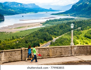 Columbia River Gorge, Oregon, USA - 9/7/2009:  Two young women at the Crown Point Vista House, overlooking the Columbia River in the Columbia River Gorge National Scenic Area