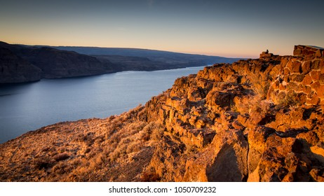 Columbia River Gorge at sunset from an Interstate 90 overlook in Washington state. The scale of this landscape can be seen in the person standing on the overlook upper frame right.
