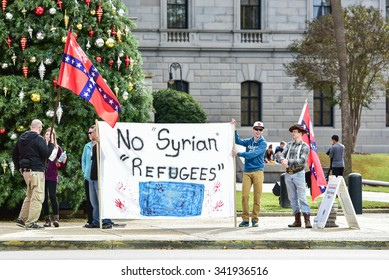 Columbia, SC - November 21, 2015: Neo-Confederates hold a rally at the South Carolina Statehouse to express their opposition to Syrian refuges seeking asylum in America.
