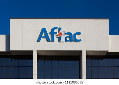 COLUMBIA, SC/USA - JUNE 4, 2018: Aflac Insurance corporate building and trademark logo. American Family Life Assurance Company is an American insurance company.