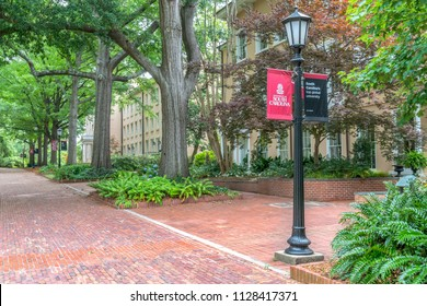 COLUMBIA, SC/USA JUNE 5, 2018: Gardens and walkway with school logo on the campus of the University of South Carolina.