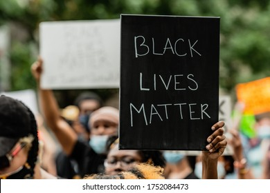 Columbia, South Carolina - USA - May 30, 2020: Protesters march from Columbia City Hall to the South Carolina State House to protest the death of George Floyd.