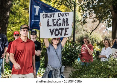 Columbia, South Carolina - USA - November 7, 2020: Trump supporters march around the SC State House in protest of the former Vice President Joe Biden (D) wining the 2020 presidential election.