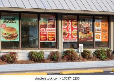 COLUMBUS, GEORGIA/ USA - 03-29-2020 Burger King restaurant in the USA advertising menu options in store window.