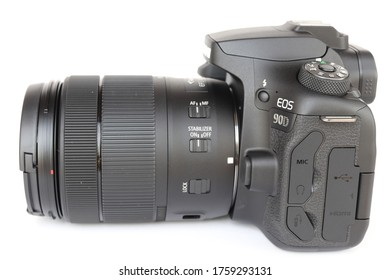 COLUMBUS, GEORGIA/ USA - 12-25-2019 Side view of a Canon Eos 90D with EF-S 18-135mm f/3.5-5.6 IS USM lens.