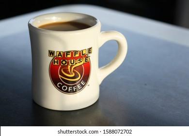 COLUMBUS, GEORGIA/USA - 02-05-2019  Close up of a mug with Waffle House logo.