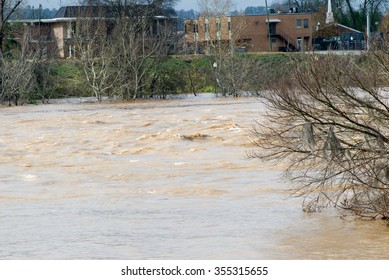 Columbus, Georgia/USA - December 25, 2015: View from the Riverwalk in Columbus, Georgia of the Chattahoochee River as it reaches flood levels after several days of non-stop rainy weather.