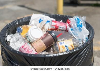 Columbus, NJ June 9, 2019: A bin-full of trash on the street of New Jersey City. - Image