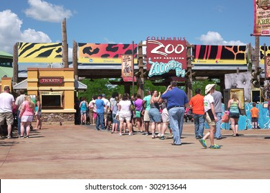 COLUMBUS, OH - AUGUST 1: People standing in line at Columbus Zoo and Aquarium during hot summer months on August 1, 2015 in Columbus, Ohio.