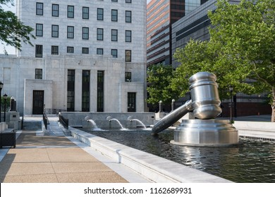 COLUMBUS, OH - JUNE 17, 2018: Stainless steel gavel sculpture created by Andrew Scott located in the courtyard of the Ohio Judicial Center in downtown Columbus, Ohio