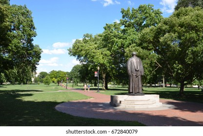 COLUMBUS, OH - JUNE 25: A statue of past president William Oxley Thompson overlooks the Oval at Ohio State University in Columbus, Ohio on June 25, 2017.