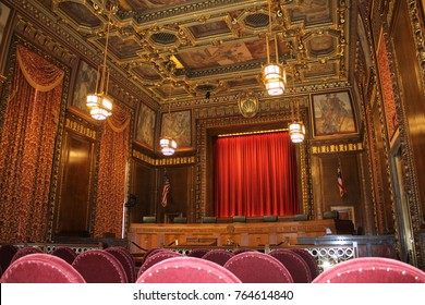 COLUMBUS OH - NOVEMBER 2017: Main Courtroom, Ohio Judicial Center, Ohio Supreme Court, Columbus Ohio in November 2017. Ceiling and wall murals depict events in Ohio and surrounding states.