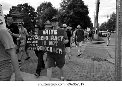 "Columbus, Ohio- August 14, 2017: Editorial. A protest, march and ""die in"" to speak out against the racial violence in Charlottesville, VA  on Aug. 13 2017 that resulted in the death of Heather Heyer"