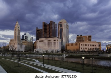COLUMBUS, OHIO - CIRCA FEBRUARY 2017: Evening Columbus Ohio skyline with angry clouds along the Scioto River at dusk