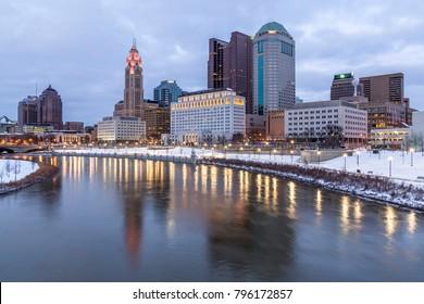 COLUMBUS, OHIO - CIRCA JANUARY 2018: Evening Columbus Ohio skyline along the Scioto River at dusk