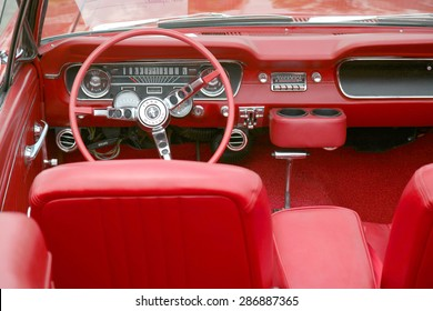 COLUMBUS, OHIO - CIRCA June 2015: Vintage classic 1965 red Ford Mustang interior on display the Davis-Shai Car and Vendor Show