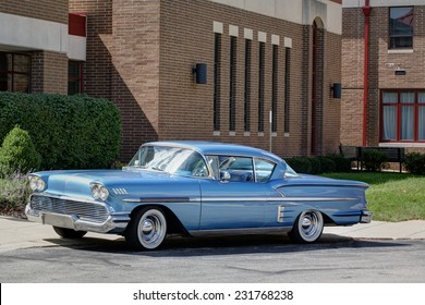COLUMBUS, OHIO - CIRCA SEPTEMBER 14, 2014: Firefighters 4 Kids Classic Car and Motorcycle Show. A blue Chevrolet Impala is parked outside.