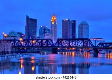 Columbus, Ohio cityscape overlooking the Scioto River at night.