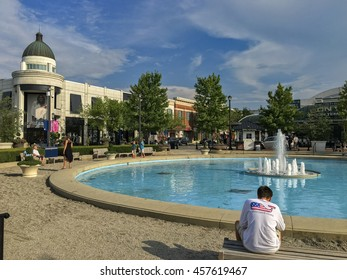 COLUMBUS, OHIO- JULY 24, 2016: Shoppers relax near the fountain at the Easton Town Center mall on a hot summer day. The temperature hit 91 degrees fahrenheit and the humidity made it feel even warmer.