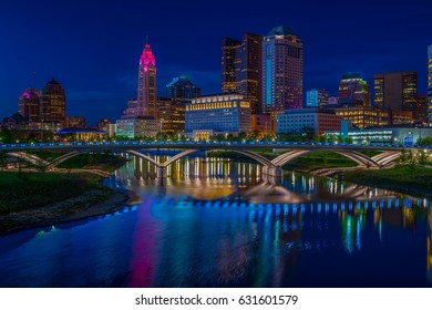 Columbus Ohio reflected in Scioto River at night  with Rich Street Bridge lights on