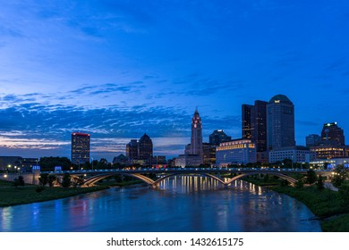 Columbus Ohio Skyline during the blue hour with the Scioto river as foreground