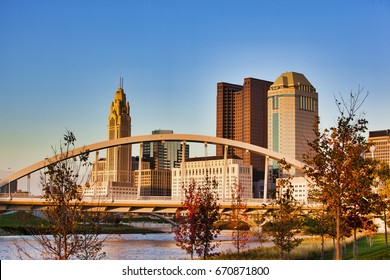 The Columbus, Ohio skyline in the fall with the Main Street Bridge in the foreground
