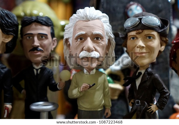 Columbus, Ohio / USA - 04.17.2018 - close up bobblehead figures with Albert Einstein Tesla and Amelia Earhart