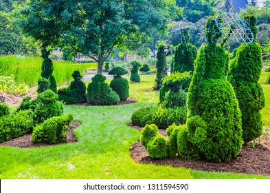 Columbus, Ohio - USA - 06-22-2014: The Topiary Garden Park in Columbus, Ohio sits on the remnants of the Old Deaf School Park and depicts a living recreation of Georges Seurat's Sunday in the Park.