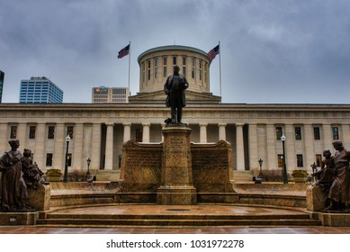 COLUMBUS, OHIO, USA - FEBRUARY 2018: William McKinley, XVth president of the United States monument near Ohio Statehouse. Statehouse is built in Greek Revival style