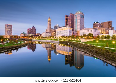Columbus, Ohio, USA skyline on the river at dusk.